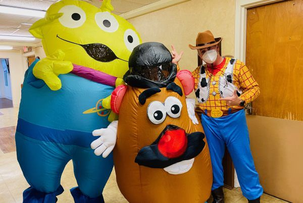 Members of the life enrichment team dressed up like characters from Toy Story.